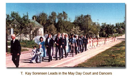 T. Kay Sorensen leads in the 1986 May Day Court and May Day Dancers.